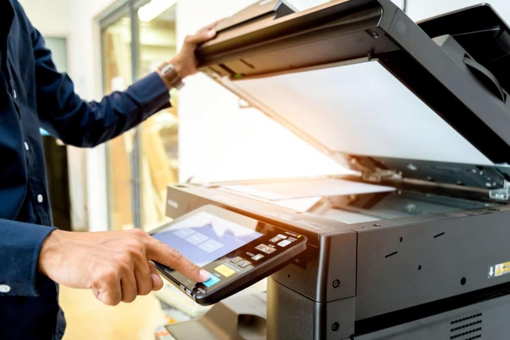 Man making a copy on a copy machine