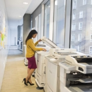 Full length of businesswoman using photocopier