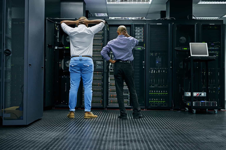 managed IT services - men in server room - network crash