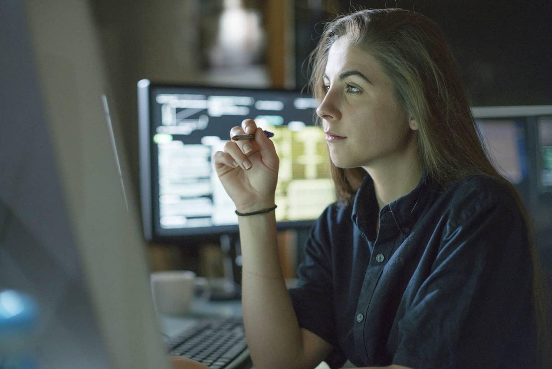 Network Monitoring woman at computer
