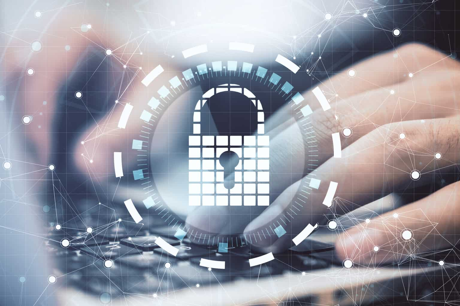 Close up of hands using laptop with digital padlock interface on desktop and blurry background. Safety and protection concept. Multiexposure