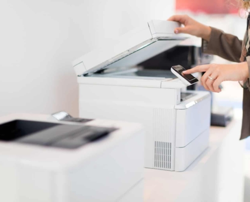 Unrecognizable woman making copies in office
